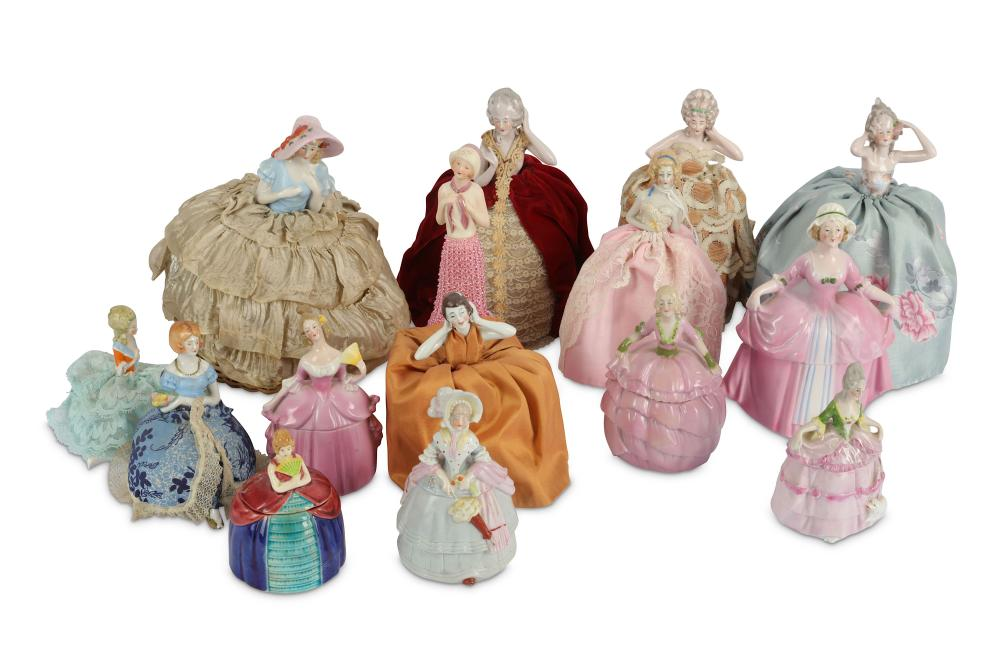 A large collection of approximately 100 half dolls and similar items
