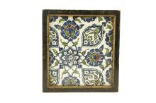 A DAMASCUS POTTERY TILE  16th-17th Century  Decoratedin blue, turquoise, purple, green and black outline on a white ground with arabesque and stylised floral design, the elements conjoined by leafy tendrils, mounted in a wooden frame, 19.5cm x 21.5cm   Provenance:  Acquired from Monks of Kensignton Church Street in the 1950s.  The Collection of the Victoria and Albert Museum between 1898 and 1952, when it was deaccessioned from the museum and then sold through Robinson and Foster Ltd, Harrington Road, London on 9 September 1953.  Previously in the collection of, painter and ceramics collector, Henry Wallis (1830-1916).  Accompanied by copies of the correspondence with Judith Crouch from the Ceramics and Glass Department at the Victoria and Albert Museum dated to 1995.