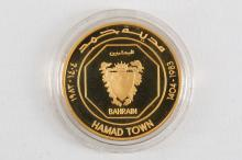 A 22ct Bahrain 'Hamad Town' 16g gold coin, in case.