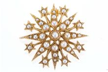 A gold and seed pearl star brooch