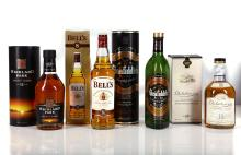 A SELECTION OF FOUR 1970'S MALT AND BLENDED WHISKIES, to include a Glenfiddich Special Reserve Single Malt Scotch Whiskey, 70cl, (40%ABV), in original card 'tin'. A Highland Park 12 year old Single Malt Scotch Whiskey, 700ml, (40%ABV), in original card 'tin'. A Dalwhinnie 15 year old Single Highland Malt Scotch Whisky, 70cl, (43%ABV), in original card box, and a Bell's 8 year old blended Scotch Whisky, 70cl, (40%ABV), in original card box. (4).