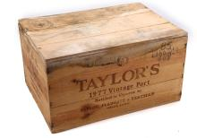 A CASE OF TWELVE 1977 TAYLOR'S VINTAGE PORT,  unopened original wood case, 75cl, (21% ABV).  *This case has been stored in a professional private cellar at between 52-55°F*.
