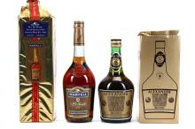 A 1980's COURVOISIER V.S. COGNAC,  fill level approximately 7cm below cork, 70cl, (40% ABV).  Also a 1980's MARTELL V.S. FINE COGNAC, Christmas edition, fill level approximately 7.5cm below cork, card box, 70cl, (40% ABV),   and a 1980's HAGGIPAVLU 'ALEXANDER' BRANDY, (Cyprus, Limassol), original card box, 750ml, (38% ABV),(3).