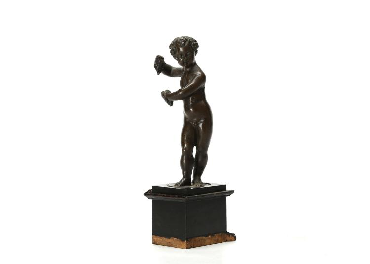 "ANDREA DI BARTOLOMEO DI ALESSANDRI, CALLED 'ANDREA DAI BRONZI' OR 'IL BRESCIANO' (ITALIAN, 1530-1569): A VENETIAN MID 16TH CENTURY BRONZE FIGURE OF THE INFANT BACCHUS OR AUTUMN  depicted as a putt holding a bunch of grapes in both hands, raised on a later pedestal,  the bronze 22.5cm high, the pedestal 31.5cm high   PROVENANCE: CHARLES AVERY COLLECTION  Charles Avery is a specialist in European sculpture, particularly Italian, French, English, Flemish and Dutch. A graduate in Classics at Cambridge University, he obtained a Diploma in the History of Art at the Courtauld Institute and a doctorate for published work from Cambridge.   Having been Deputy Keeper of Sculpture at the Victoria and Albert Museum for twelve years (1966-79), and a Director of Christies for ten years, since 1990 he has been a highly respected, independent historian, consultant, writer and lecturer.   His books include 'Florentine Renaissance Sculpture', 1970, 'Giambologna the Complete Sculpture', Phaidon, 1987, 'Donatello: An Introduction', John Murray, 1994; 'Bernini, Genius of the Baroque', Thames and Hudson, 1997 (paperback, 2006),  and 'The Triumph of Motion: Francesco Bertos', 2008.     Purchased by Dr Avery from Hugo & Ruth Klotz, New York (believed to be from the Weinberg Collection, Frankfurt, inv. no. 155); sold Christie's, New York, 28 September 2006, lot 147 for $6,000.   Related Literature:  C. and V. Avery, ""Not quite Sansovino and not quite Vittoria: Andrea di Alessandri, called Il Bresciano"", in Sculpture Journal, IX, 2003, pp. 46-61.   This putto, holding a bunch of grapes in both hands, though of a type frequently associated with Niccolo Roccatagliata (as it was in the Christie's catalogue entry), accords equally well with those from a generation earlier that populate several of Il Bresciano's elaborate complexes in bronze, such as his Base for the Reliquary Cross of St Theodore of 1567 in the Accademia, Venice, or the Firedogs from the Bute Collection (see Avery 2003, figs. 12-13).   ""Andrea dai bronzi"" was a sculptor-foundryman who worked in the Venetian milieu of the better known masters, Sansovino and Vittoria. His real name, Andrea di Bartolomeo di Alessandri, has recently been established, but he was also sometimes known from his native county-town as ""Il Bresciano"". His masterpiece is the signed Paschal Candelabrum for Jacopo Sansovino's church of Santo Spirito in Isola, now in Santa Maria della Salute, Venice.   The integrally cast, oval base-plate, with a hole pierced through its centre and a hollow screw-thread indicates that this putto was the terminal of a complex, perhaps a firedog, with one or more matching companions, either appropriate deities, or infant allegories of The Four Seasons, a popular theme, where winter's cold was related to the warmth of the nearby fire."