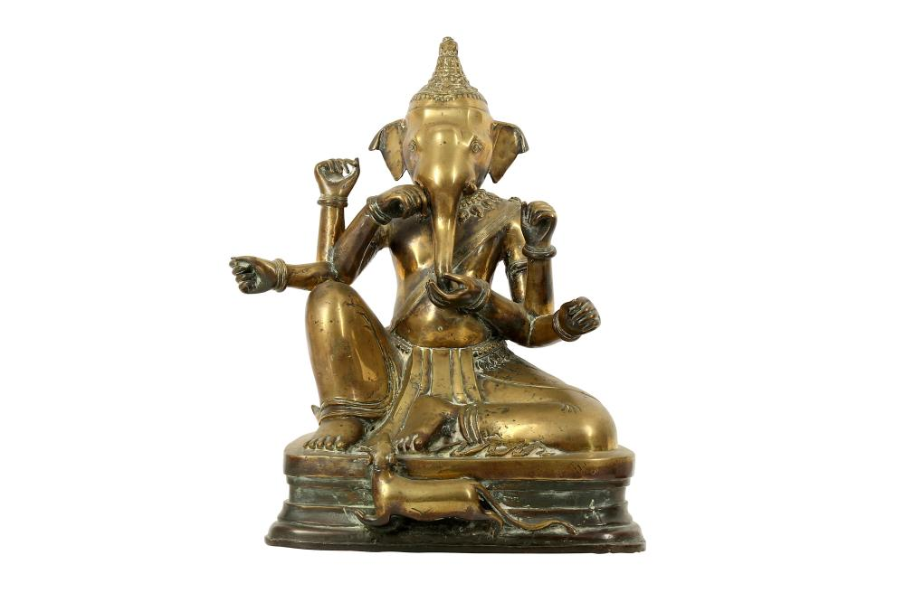 A DEVOTIONAL BRASS SCULPTURE OF THE HINDU GOD, LORD GANESHA Possibly India or Thailand, South East Asia, late 19th century