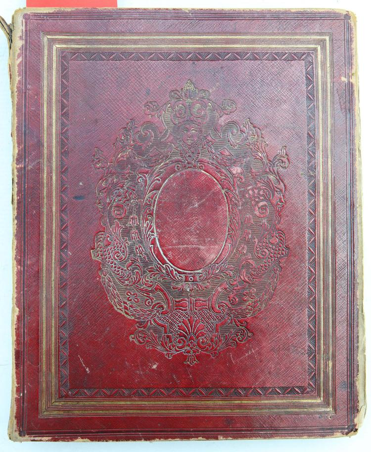 ALBUM - [c. 1836-90]. Containing watercolours, engravings, sketches, pressed flowers, jottings and photographs. Contemporary red calf tooled in blind (first few pages detached, text block detached from backstrip, extremities rubbed). Provenance: Emma Hardy (dedication from Agnes Wall dated April 16th,1836). Includes a number of autograph passages by Emma Hardy, initialled 'E. H.' An attached note remarks on the connection of the album with the Hardy Wigglesworth family.