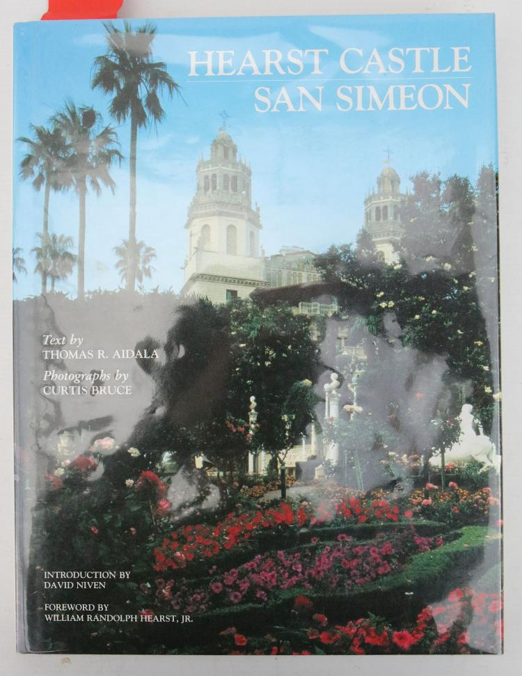 Hearst Castle. New York: Hudson Hills Press, 1981. Folio. Original yellow cloth with blue photographic dust-jacket. Provenance: Lord Edward Montagu of Beaulieu (inscription from Frank A. Bennack Jr., the Vice Chairman of Hearst, the publishing and broadcasting company,