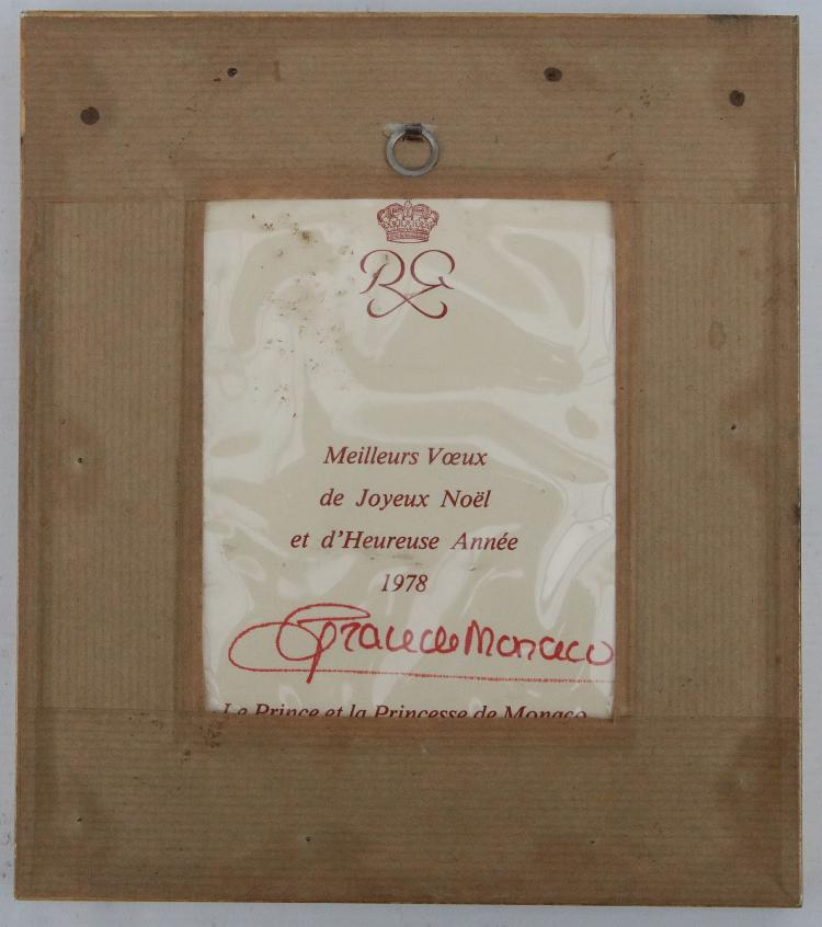 PRINCESS GRACE of Monaco (1929-82). Christmas Card depicting Princess Grace seated, SIGNED by Princess Grace in red ink, with the printed text on the verso reading: