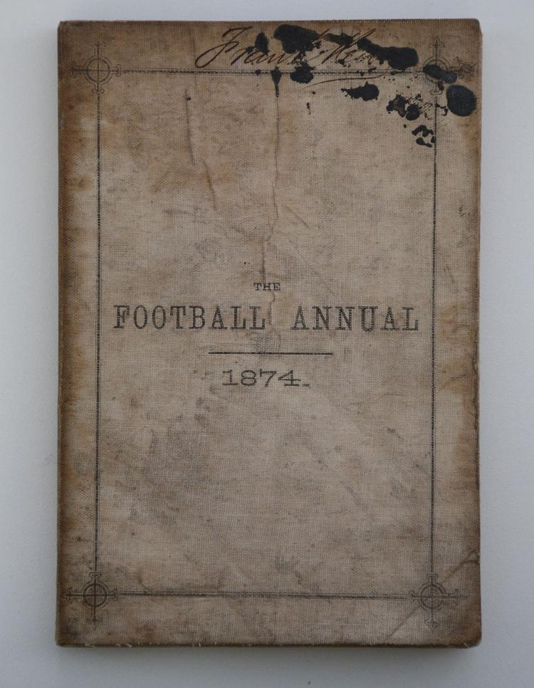 FOOTBALL - Charles William ALCOCK (1842-1907, editor).  The Football Annual. Published with the Sanction of the Football Association ... [Seventh Year of Publication.] London: Virtue & Co., 1874. 8vo (178 x 120mm). Advertisements, diagram (title lightly spotted and stained, some light mainly marginal spotting and staining). Original cream linen wrappers (lightly soiled and stained, ink blots obscuring signature). Provenance: Frank [?]Kelly (old signature on upper wrapper). RARE. The editor, who instigated the F.A. Cup, was a key figure in the history of football, as an administrator, innovator and player. He captained the England team in the first ever recorded international game, against Scotland in 1870.