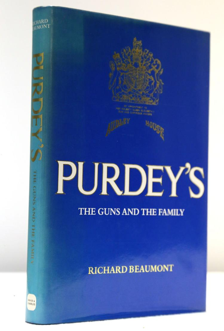 BEAUMONT, Richard.  Purdey's. The Guns and the Family. London: David & Charles, 1984. Large 8vo. Black cloth (rubbed), blue dust-jacket (faded). PRESENTATION COPY, inscribed,