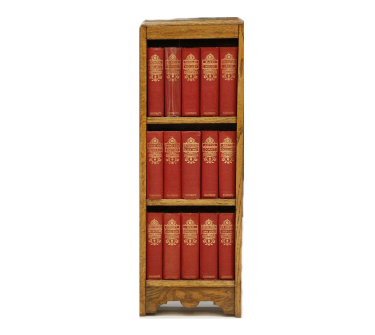 DICKENS, Charles (1812-70).  [Selected Works. London: Facsimile Edition, n.d.]. 30 volumes bound in 15, 8vo. Wood-engraved title vignettes and plates. Original red cloth decorated in blind, the spines lettered in gilt. Contained in a custom-made 3-tier oak book case, 885(h)x 305mm.(w), early 20th-century. (15)