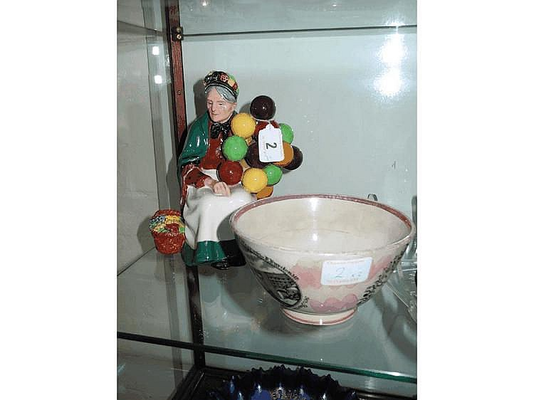 A Royal Doulton model of 'The Balloon Seller',