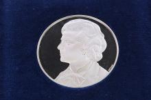 A Spink silver medal sculpted by Philip Nathan commemorating the visit of Mrs Thatcher to the Falklands in January 1983, issue limit of 500, featuring on one side the profile portrait of Thatcher and on the reverse a lion with shield, housed in blue silk and velvet presentation case.