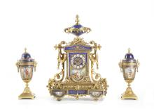 A LATE 19TH CENTURY FRENCH GILT BRONZE AND PORCELAIN MOUNTED CLOCK GARNITURE