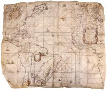 Blaeu (Willem) Pieter Goos and Johannes van Keulen.   West Indische Paskaert waer in de graden de breedde over weder zijden vande middellijn wassende...rare and historic Atlantic sea chart printed on vellum, large decorative title cartouche in Africa, centre right, supported by native figures, one holding a large elephant's tusk, with garlands of fruit below, lions and an ostrich to either side, publisher's cartouche of Pieter Goos and van Keulen, upper left, various national arms over Europe, and those of France, the Netherlands, Great Britain and Spain arranged in that order over North America, large inset chart of the southern tip of South America within Brazil, compass roses, rhum lines, ships and sea monsters, also with several routes plotted by hand, the most visible in sepia pigment from Brest in France, via the Azores to São Tomé and Principe island in the Gulf of Guinea off West Africa, others less discernible also from France, probably Nantes, and possibly Portugal to the West Indies,engraved chart printed on vellum with original hand-colouring to coastal outlines, cartouches and other occasional details, 775 x 925mm., the vellum sheet 810 x 960mm., with usual cockling, particularly to corners, aside from a vertical and a horizontal central fold, some surface dirt and slight wear, two small wormholes and another small hole due to green pigment corrosion on a sea monster, lower left, [Burden 233, derivative map; Schilder, Monumenta, vol IV, p.114], Amsterdam, van Keulen, [c.1680].   Although there is some debate over whether publication of this map should be Burden's state 3 in the succession of ownership of a single copperplate originally produced by Willem Blaeu around 1630, or if it was a variant plate, as Burden argues, created by Johannes van Keulen around 1680, the latter would appear to be the case from this example by close comparison with the 4th state of c.1693 issued by Johannes Loots. The split of the name 'Africæ' by the title cartouche is one 