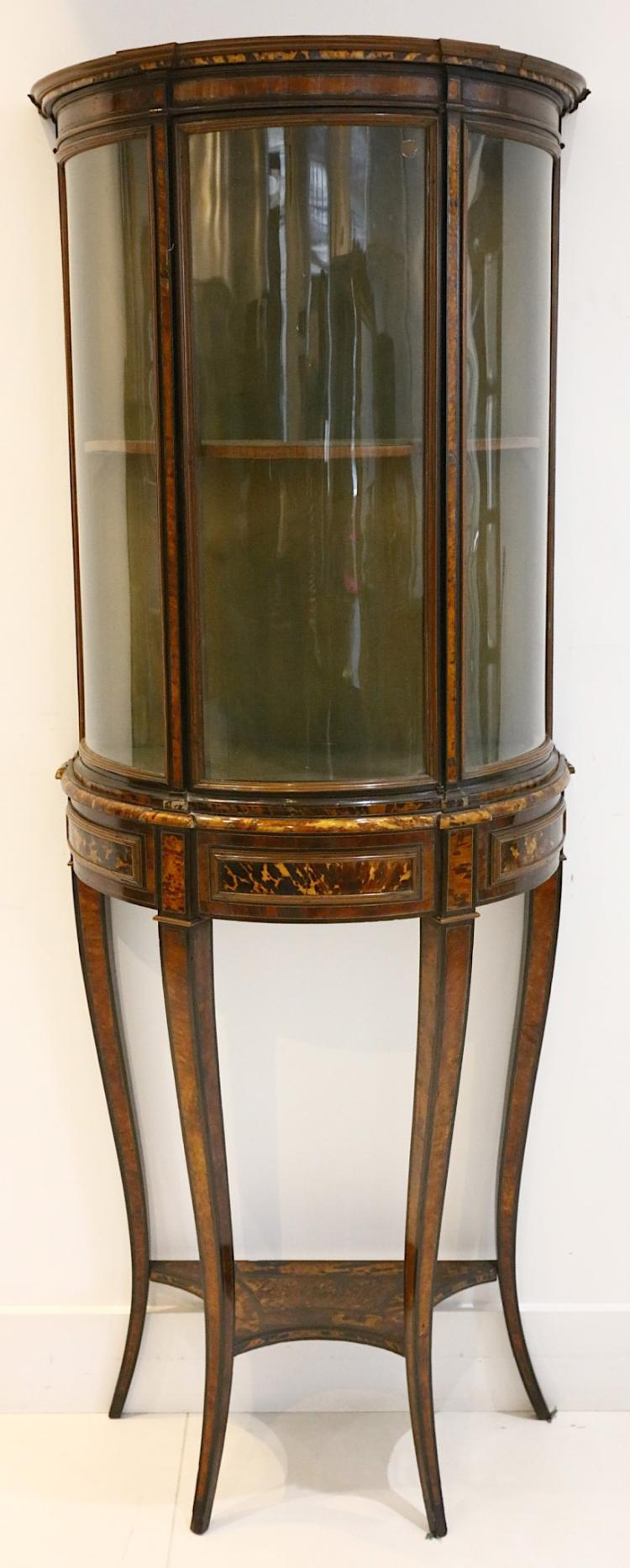 A bow front display cabinet, 19th century, possibl