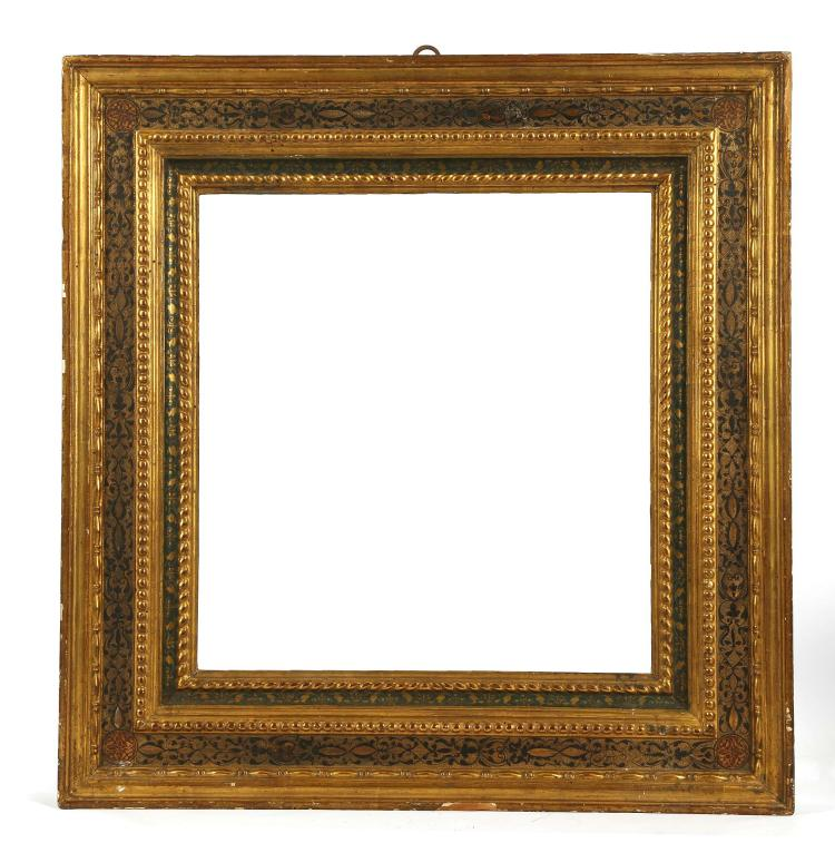 A FINE RENAISSANCE FRAME, with painted and decorated gesso and gilt. With an outer design of black ebonised scroll and fleur de l'isle, with an innesband hand-painted in steel blue. Outer dimensions: 69.5cm x 67cm.