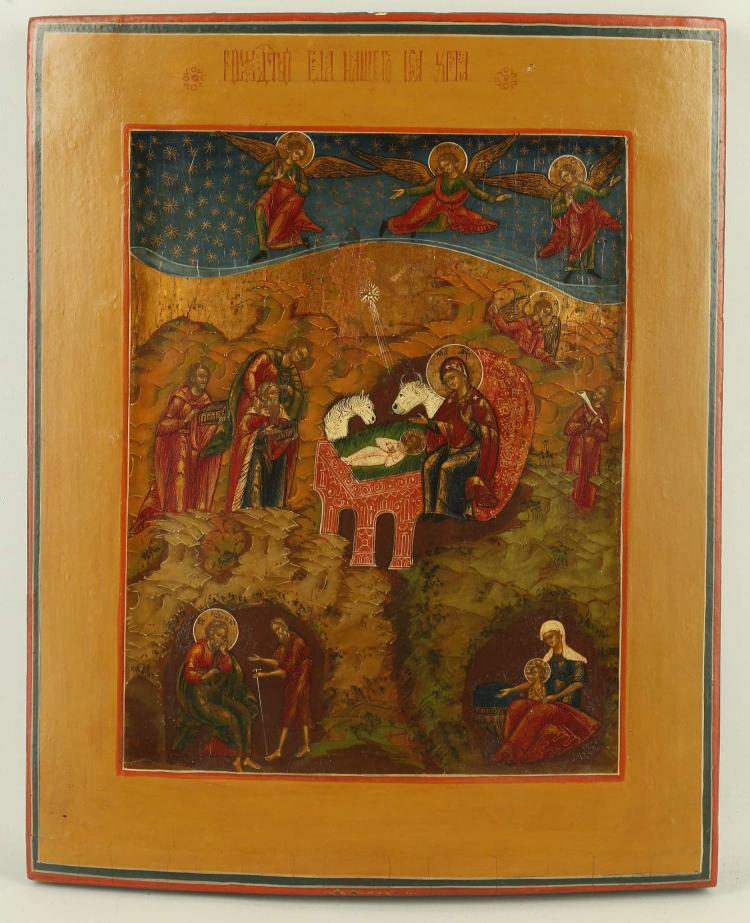A FINE RUSSIAN ICON: THE NATIVITY OF THE LORD, 19TH CENTURY. At center is Mary watching over the newborn Christ as an ox and ass look on. To the left the wise men bring gifts, to the right an angel appears to a shepherd. At lower left the devil, in the disguise of an old shepherd, is tempting Joseph to doubt the trust of the Virgin birth. At lower left the midwife Zelomi prepares to wash the newborn child. The upper margin filled with gold stars against a blue scroll of heaven upon which are seen Angels of the Lord watching over the event below. The inscription along the upper margin identifies the subject as 'The Birth of Our Lord Jesus Christ'. A beautiful icon. 13 x 10.5 inches.
