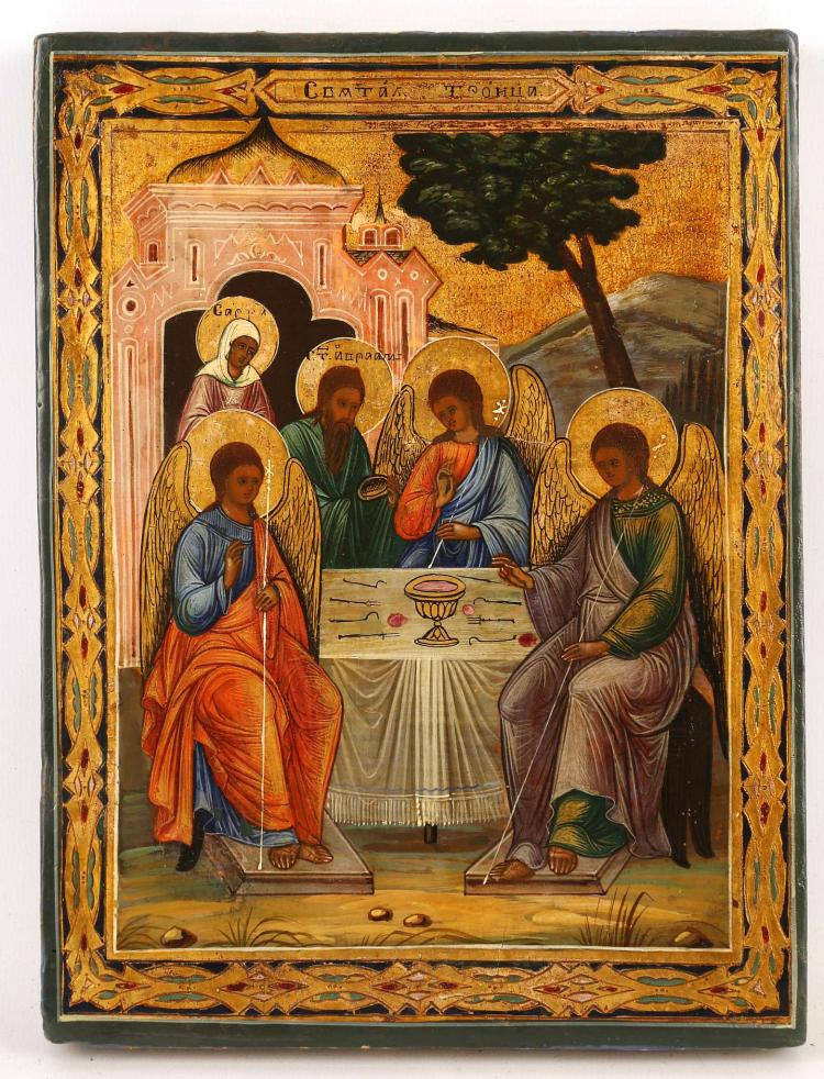 A RUSSIAN ICON OF THE OLD TESTAMENT TRINITY, CIRCA 1890. Here the three angels of the Lord who appeared to Abraham at the Oak of Mamre, as recorded in chapter 18 of the book of Genesis are depicted. Behind, Abraham serves them as his wife Sarah looks on. The inscription at top identifies the subject as 'The Holy Trinity', 8.75 x 6.5 inches.