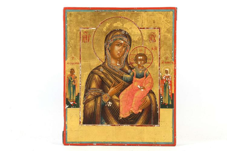 RUSSIAN ICON: THE SMOLENSK MOTHER OF GOD, CIRCA 1850, URAL SCHOOL. An absolutely exquisite icon of this popular Mother of God type. Expertly rendered in miniature with single hair brush details all on 22 karat gold leaf ground. The left border with Saint Sebastian and on the right Saint Natalia. Fantastic condition, museum quality, 9 x 7.25 inches.