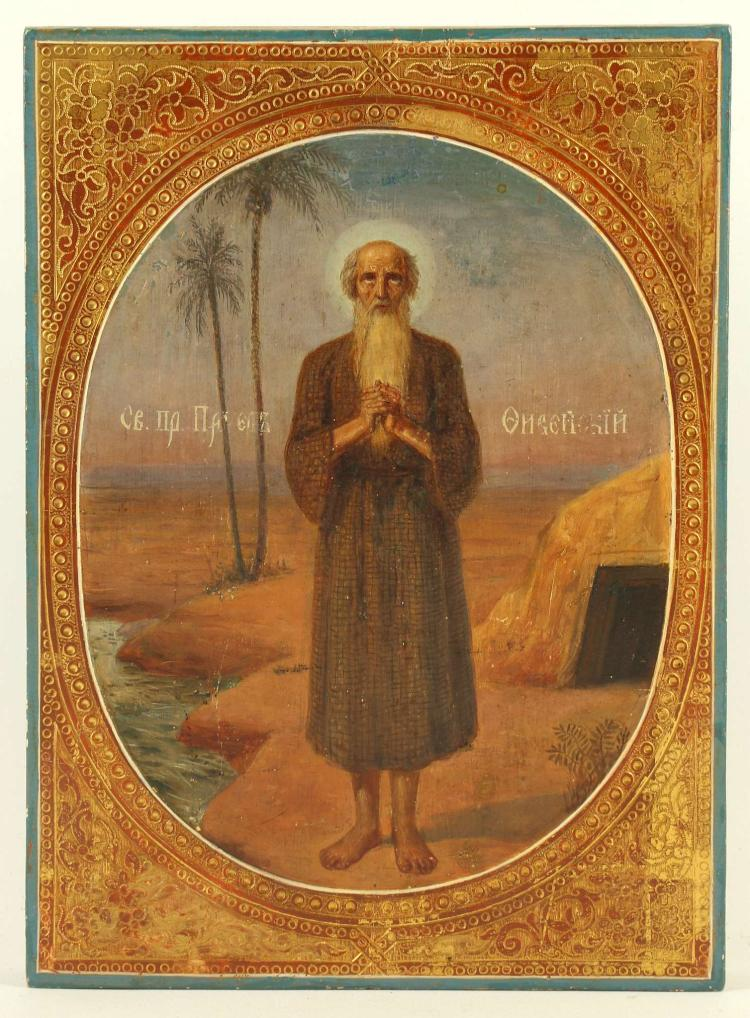 A RUSSIAN ICON: THE HOLY VENERABLE PAUL OF THEBES, CIRCA 1875. Paul inherited great wealth which he gave to his sister before he left to live an ascetic life in the desert. While there he was visited by St. Anthony the Great. Paul lived to the age of 113. He is celebrated on January 15th. An interesting icon painted with great feeling, 6.5 x 8.75 inches.