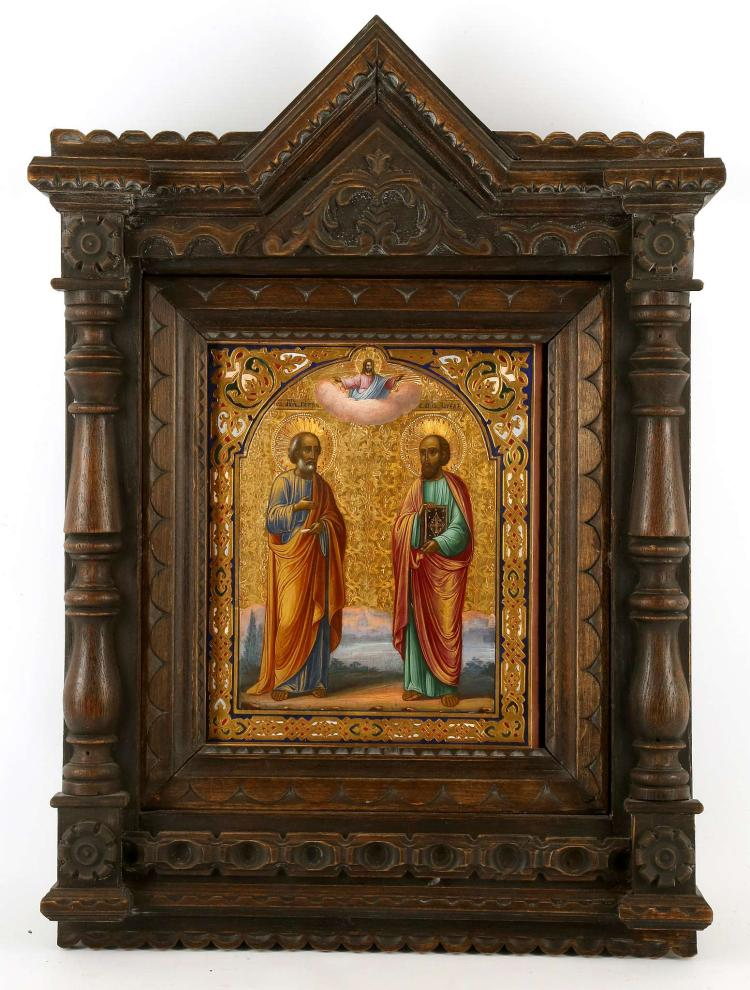 A RUSSIAN ICON: SAINTS PETER AND PAUL, circa 1890, On the left the Apostle Peter, on the right Paul, behind them the Holy and and above Christ delivering a blessing. The borders ornately inscribed and colourfully decorated against a gold leaf ground. The icon set in a hand carved custom fitted kiot. Overall dimensions including kiot 23 x 16.5 inches.