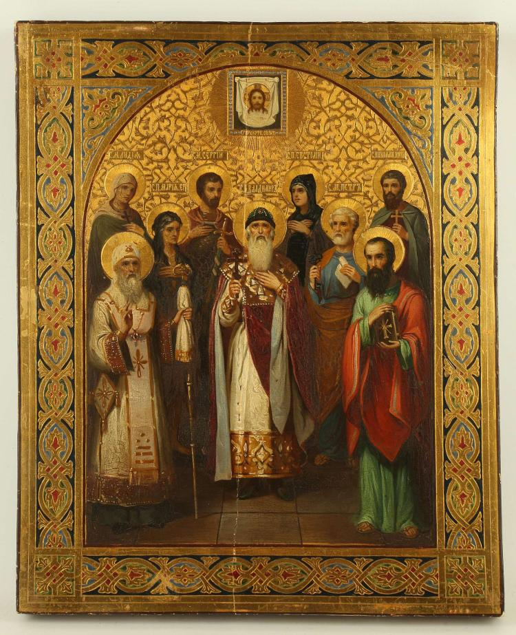 A RUSSIAN ICON: SELECTED SAINTS, CIRCA 1900. Icons such as the offered lot are often referred to as 'Family' icons. That is because it was quite common for parents to commission an icon that would display all the 'name' saints of ones family. In this example the following saints are depicted: St. Lydia, St. Sergiy the Martyr, the Holy Martyr Eustolia, St. Nicholas Kochanov, St. Mary of Egypt, St. Valdmir, St. Peter, St. Paul, and the Holy Metropolitan Peter of Moscow. The style of this icon is reminiscent of the famous Russian artist Mikhail Nesterov (1862-1942). 16 x 13 inches.