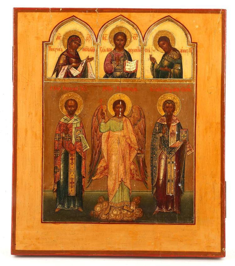 A RUSSIAN ICON: THE DEIST WITH SELECTED SAINTS, PALEKH SCHOOL, 19TH CENTURY. The top section depicting the Deisis with recess ogee-arch borders. Below St. Nicholas, the Guardian Angels and the Holy hieromartyr St. Stephen, Archbishop of Surozh. Finely painted and with unusual shaped kovcheg, 12.25 x 14 inches.