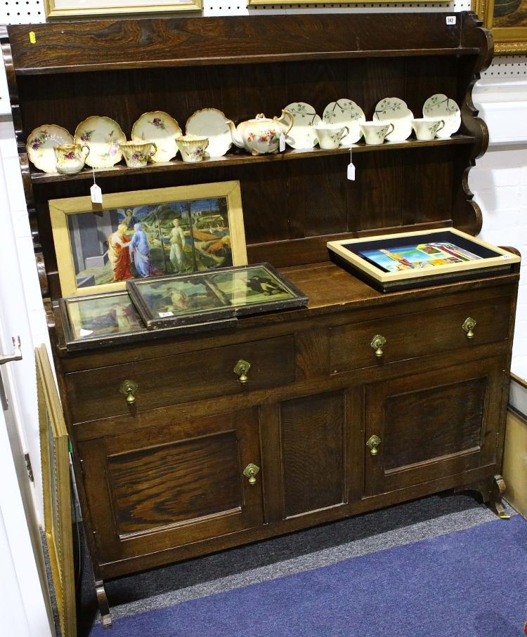 An edwardian oak dresser with brass fittings