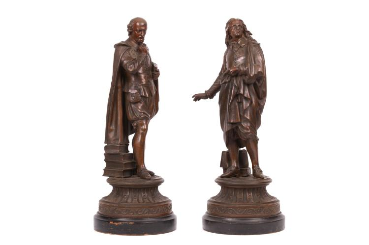 A PAIR OF LATE 19TH CENTURY SPELTER FIGURES OF SHAKESPEARE AND MILTON  each depicting standing with books at their feet, raised on waisted, circular bases over ebonised plinths,  51cm high (2)