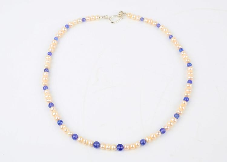 a cultured pearl and tanzanite bead necklace