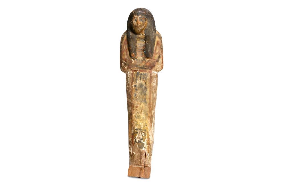 AN EGYPTIAN WOOD POLYCHROME SHABTI