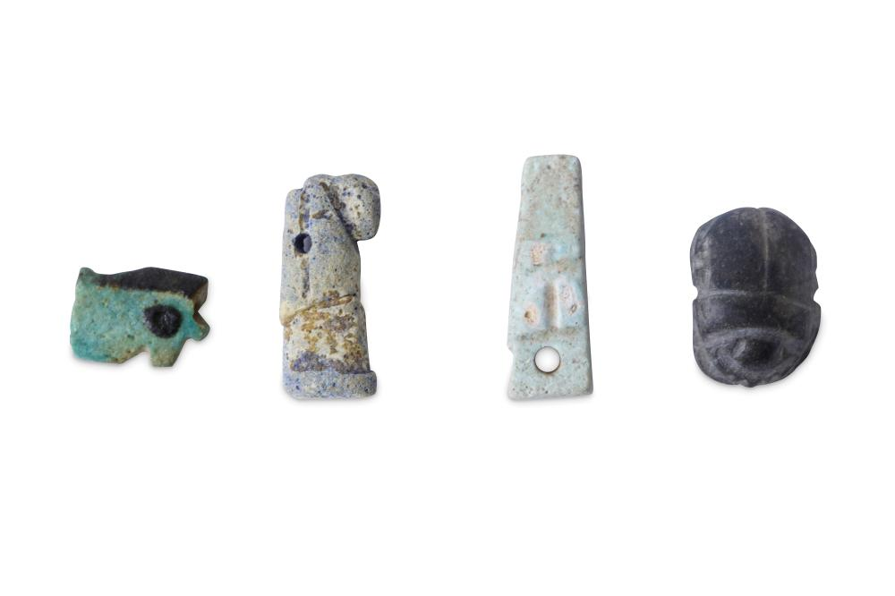 A GROUP OF EGYPTIAN FRIT AMULETS
