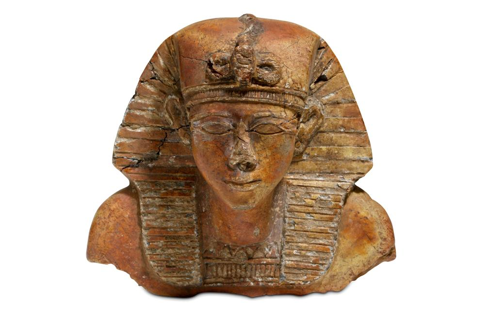 AN AFTER THE ANTIQUE STONE BUST OF A PHARAOH