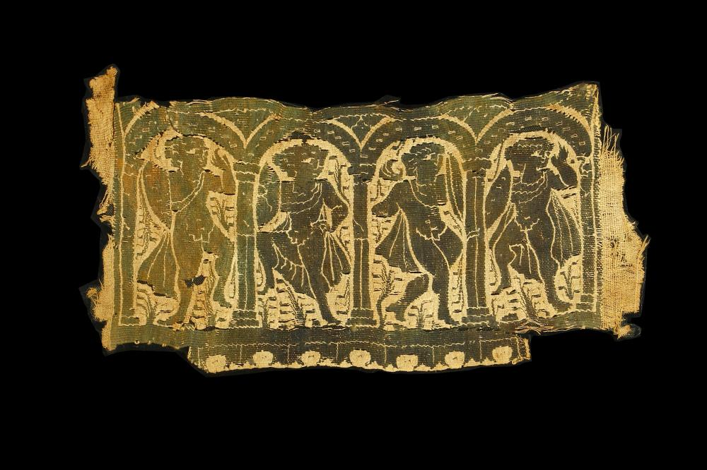 A COPTIC TEXTILE WITH DANCING SCENE