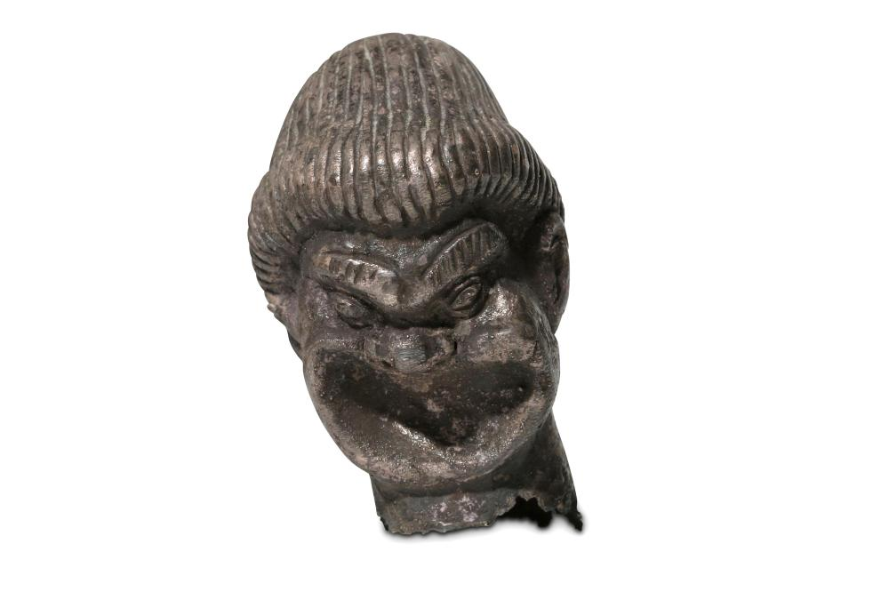 A GREEK SILVER FINIAL IN THE FORM OF A HEAD OF AN ACTOR