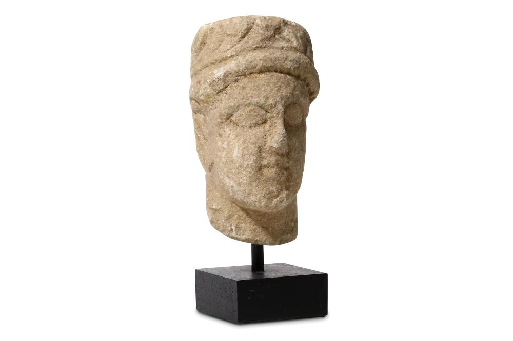 A STONE CYPRIOT HEAD