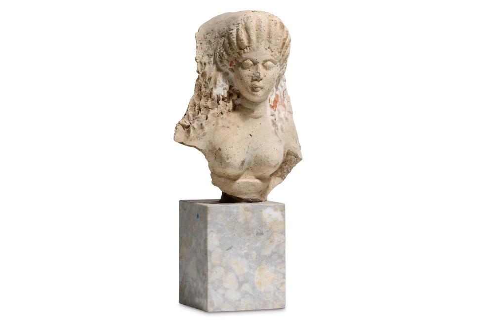 A GREEK FEMALE TERRACOTTA ANTEFIX