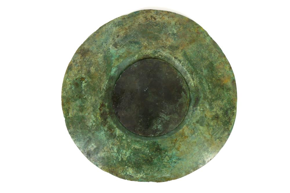A WESTERN ASIATIC BRONZE SHIELD FITTING