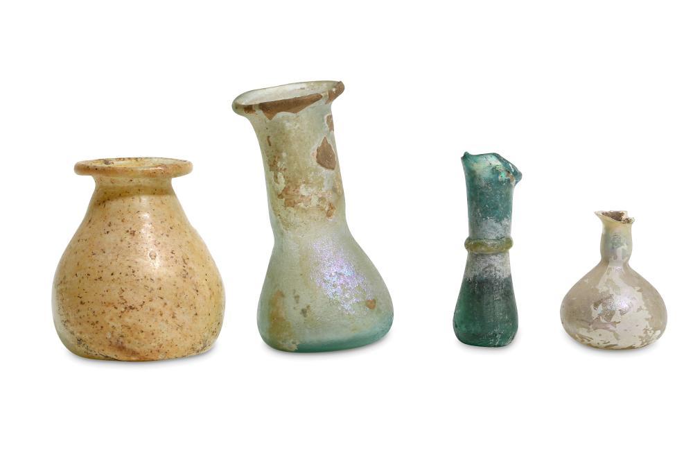 A GROUP OF ROMAN MINIATURE GLASS VESSELS