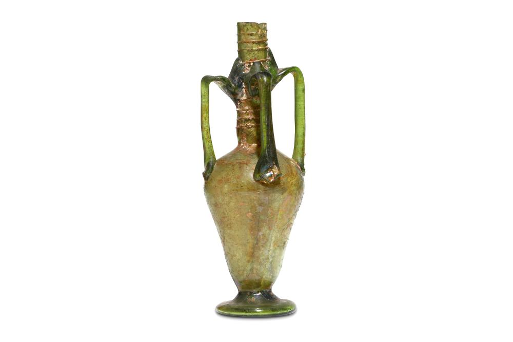 A ROMAN GREEN GLASS FOUR-HANDLED FLASK