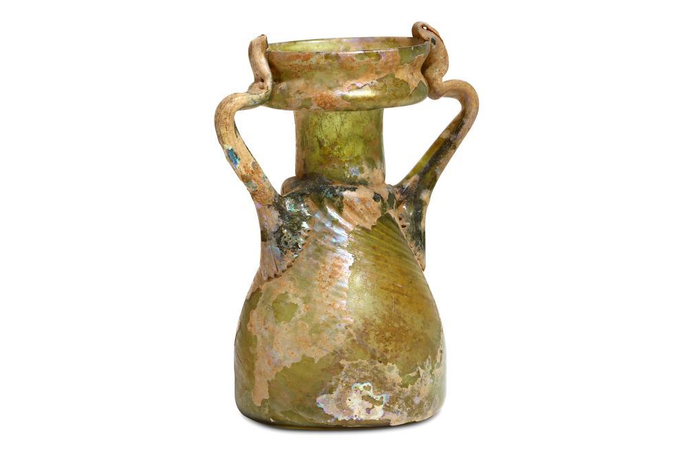 A ROMAN GREEN GLASS SPRINKLER FLASK