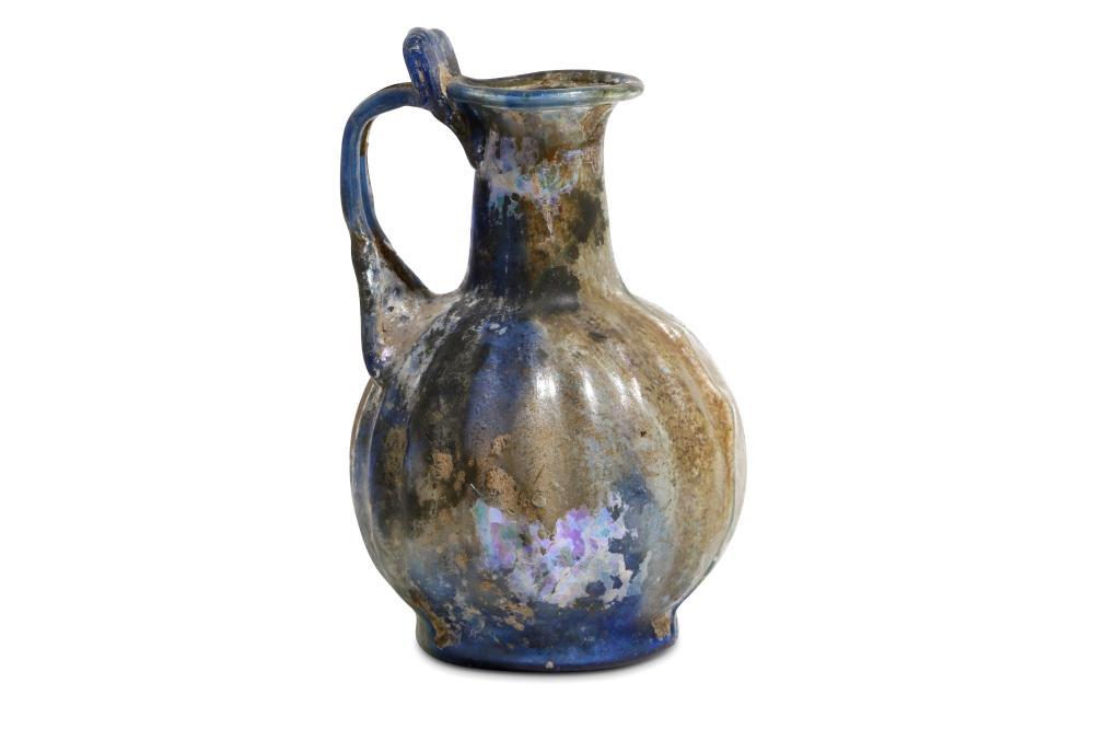 A ROMAN BLUE GLASS MOULD-BLOWN OINOCHOE
