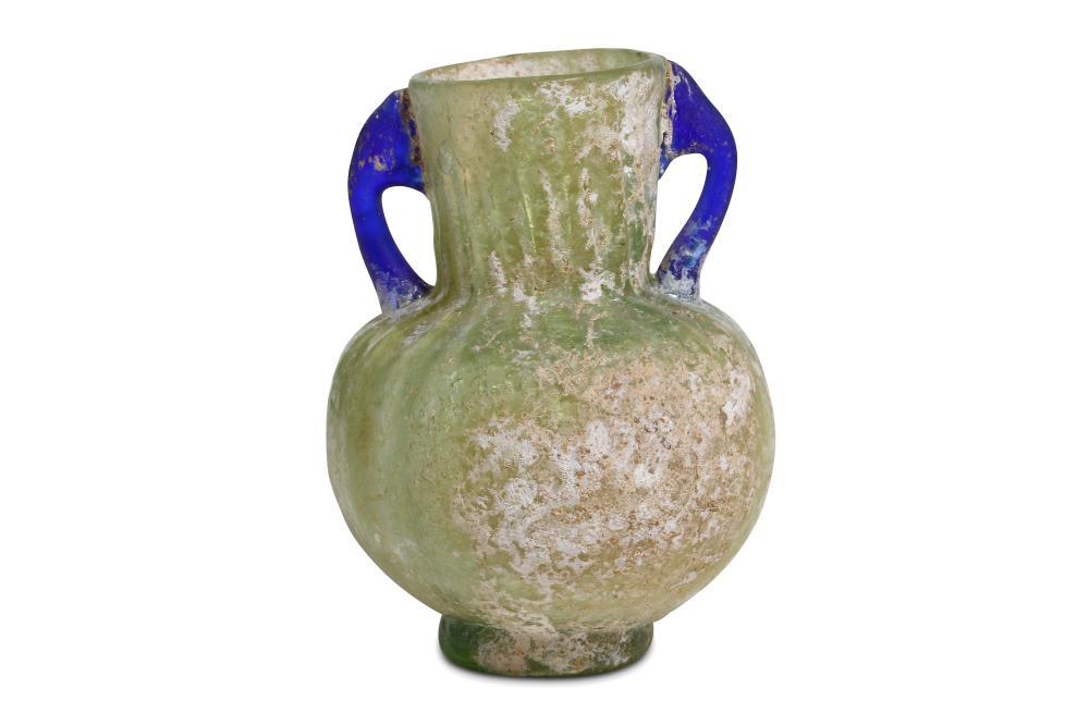A ROMAN GREEN GLASS MOULD-BLOWN FLASK