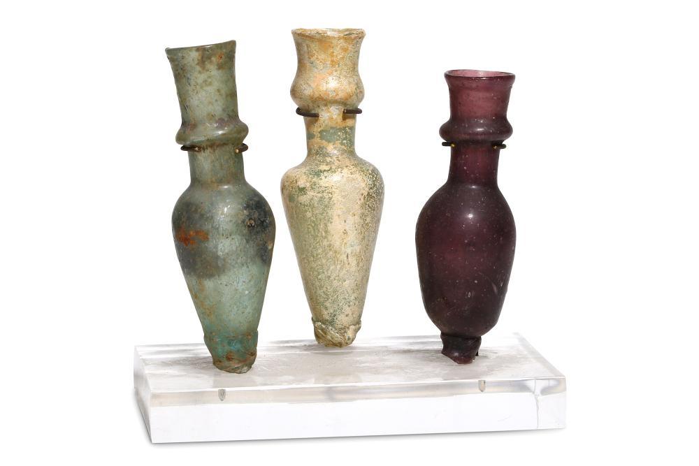 THREE ROMAN GLASS UNGUENTARIA