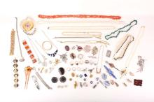 A collection of costume jewellery, Including imitation pearl necklaces, buckles, brooches and hairpins
