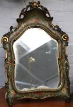 A very early 20th Century Continental vanity mirror, supported by easel, hand painted with flower sprays, enriched with gilt on green matt ground, 68cm high.