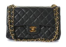 Chanel Medium Black 2.55 Classic Flap Bag, c. 1994-96, black quilted lambskin with gold tone hardware, 26cm wide, 16cm high  Condition Grade B+ Please refer to department for condition report