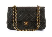 Chanel Medium Black 2.55 Classic Flap Bag, c. 1994-96, quilted black lambskin with gold tone hardware, 26cm wide, 16cm high  Authenticity card and dust bag  Condition Grade A Please refer to department for condition report