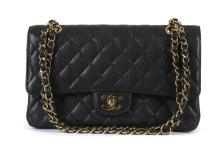 Chanel Medium Black Caviar 2.55 Classic Flap Bag, c. 2009-10, quilted black caviar leather with gold tone hardware, 25.5cm wide, 15cm high  Authenticity card, dust bag, box and ribbon  Condition Grade A Please refer to department for condition report